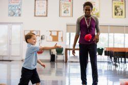 kid throwing ball
